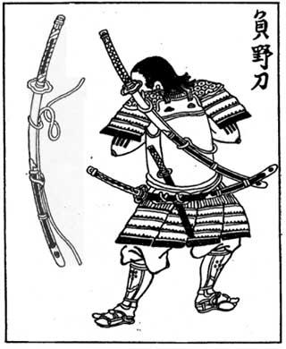 Un samurai con una odachi (grande spada giapponese) legata sulla schiena. Un modo come un altro per trasportare le armi fino al campo di battaglia. [Hayakawa Kyuukei, 1735 ca.]